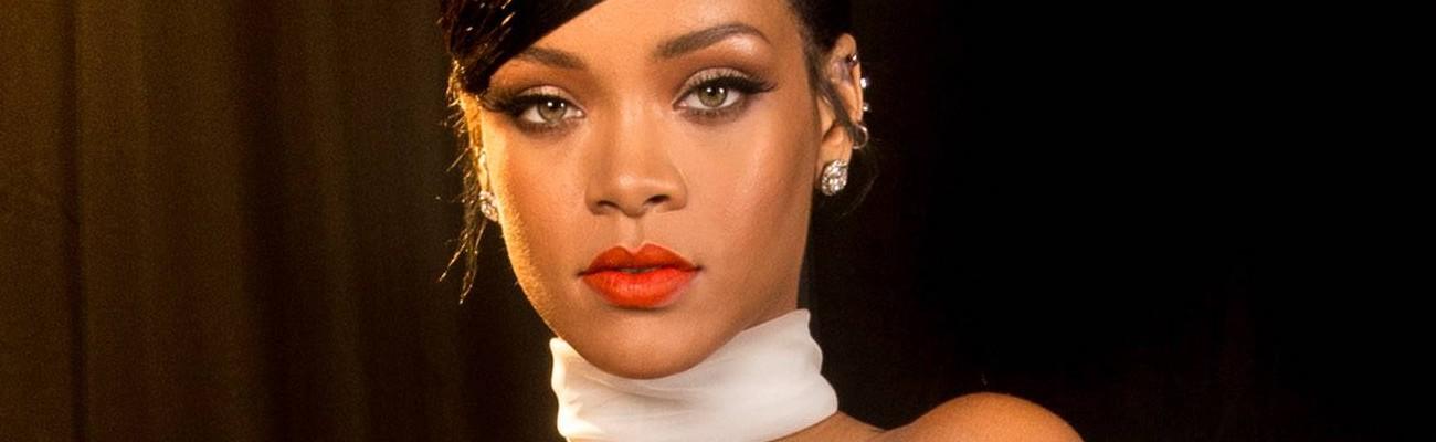 Rihanna poses for photos backstage at the amfAR Inspiration Gala