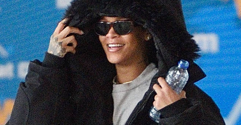 Rihanna is all smiles as she arrives at JFK in New York on October 28, 2016