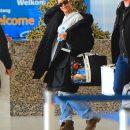 Rihanna spotted at JFK airport on October 28, 2016 black sunglasses