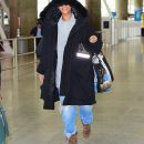 Rihanna spotted at JFK airport on October 28, 2016 jeans