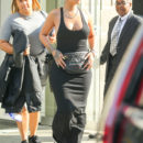 Rihanna goes braless in a tank dress and Gucci bum bag in New York City