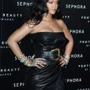 Rihanna attends Fenty Beauty launch in Milan on April 5, 2018 Body Lava