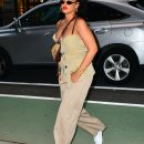 Rihanna spotted out and about in NYC on May 4, 2018 with red lipstick and sunglasses