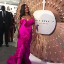 Rihanna at Fenty Beauty's anniversary party on Septemnber 14, 2018 looking at Pro Filt'r Foundation Spin Wheel