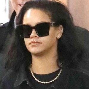 Rihanna arrives in New York in January 2019 wearing Raf Simons